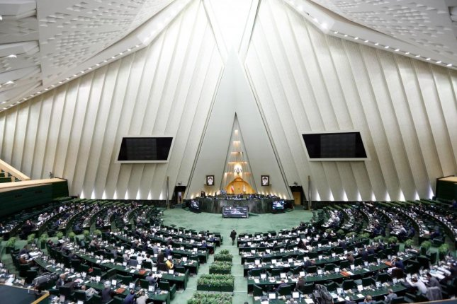 Iranian lawmakers take part during a parliament session in Tehran Tuesday, passing a bill that lists U.S. forces in the Middle East as a terrorist organization. Photo by Abedin Taherkenareh/EPA-EFE