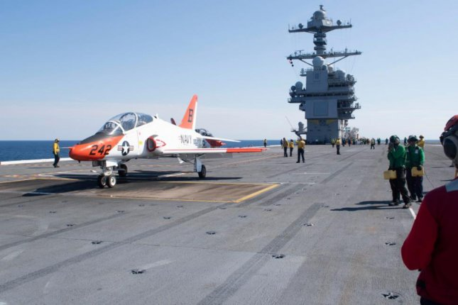 The aircraft carrier USS Gerald R. Ford underwent maintenance and construction to accommodate 1,000 additional personnel and fixed-wing and rotary aircraft for its next mission. Photo by MCS Seaman Apprentice Sawyer Connally/U.S. Navy/UPI