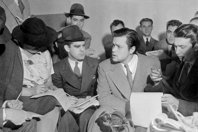 Author Orson Welles meets with reporters on October 31 1938 to explain the radio broadcast of The War of the Worlds was not expected to cause panic. Photo by Acme News/Wikipedia