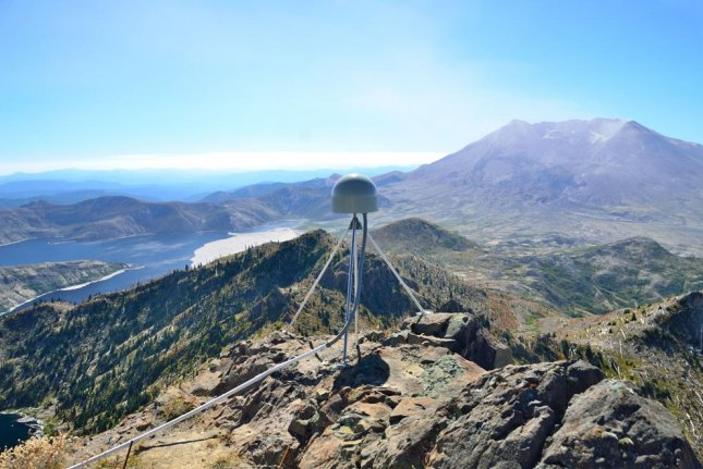 A GPS station drilled atop a peak near Mount St. Helens in Washington State. Photo by Mike Gottlieb/University of Washington