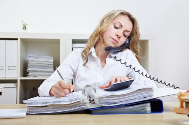 Long work hours increase risk for a variety of health conditions in women, and researchers say the combination of family and work pressures on women may increase their risk for adverse health conditions simply by juggling the parts of their lives. Photo by Robert Kneschke/Shutterstock