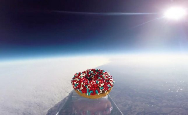 A donut shop in Kansas City has placed a donut that was launched 97,000 feet into space on display. Screen capture/Donutology/Facebook