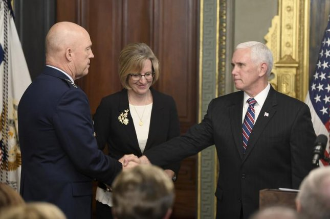 Vice President of the United States Michael Pence congratulates Gen. John Raymond after swearing him in as the first Chief of Space Operations during a ceremony in the Washington, D.C. Tuesday. Photo by Andy Morataya/U.S. Air Force