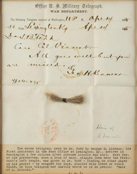 A lock of Abraham Lincoln's hair, wrapped in a telegram stained with his blood, is up for auction online. Photo courtesy RR Auction