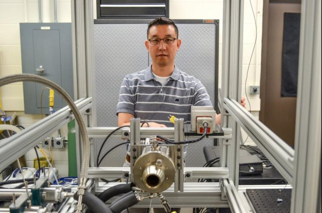 Prof. Tonghun Lee, of the University of Illinois-Urbana Champaign, demonstrates the Army Research Combustor M1 machine, designed and built at his campus in collaboration with the CCDC Army Research Laboratory. Photo courtesy of U.S. Army
