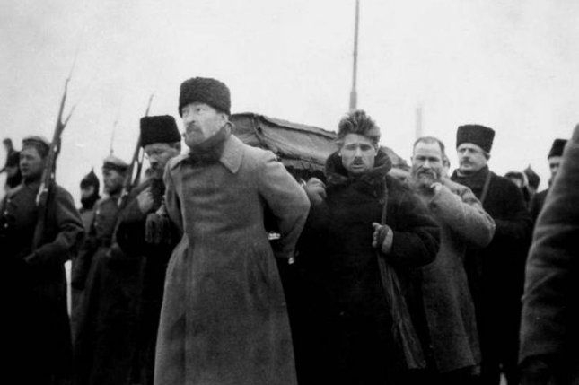 Pallbearers Carrying Vladimir Lenin's Coffin during his funeral, from Paveletsky Station to the Labor Temple. Felix Dzierżyński at the front with with Timofei Sapronov behind him and Lev Kamenev at left. Photo courtesy of Wikipedia