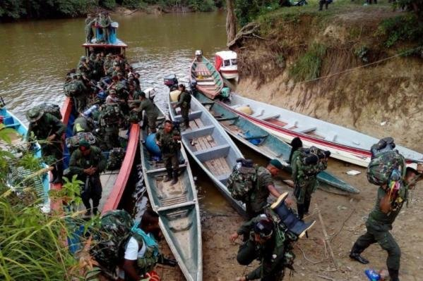 FARC members travel to reach reincorporation zones, where they will disarm, as part of a peace agreement with the Colombian government. Militants are 30 percent finished with the disarmament process. Photo courtesy of Revolutionary Army Forces of Colombia