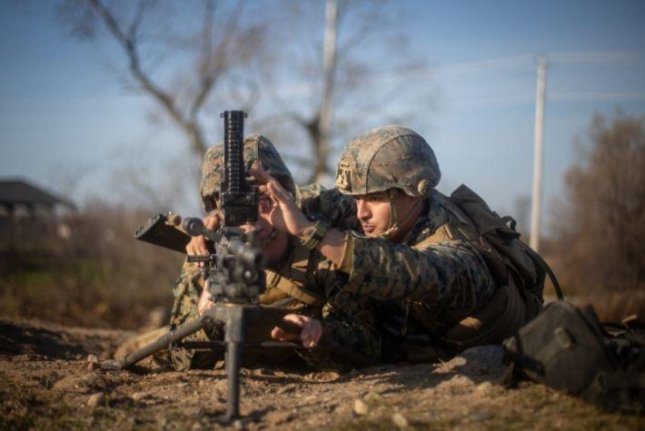 U.S. Marine Corps LCpl. Bryan Leon, L, and LCpl. Austin Dess, R, participate in the U.S. Marine Corps' MEFEX 21.1 exercise at Fort Drum, N.Y., on Nov. 6. Photo by Lance Cpl. Scott Jenkins/U.S. Marine Corps