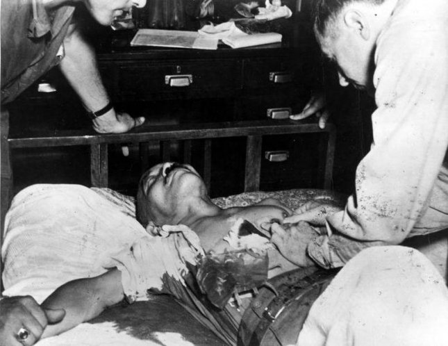 Hideki Tojo is treated after his suicide attempt during his arrest on September 11, 1945. Photo courtesy of the United Stated Government via Wikipedia.