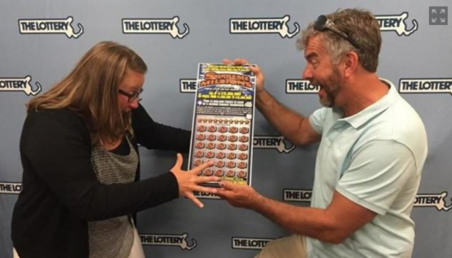 Newlyweds Stacy and David Foster hold their $15 million lottery jackpot ticket. Massechusetts State Lottery/Screenshot