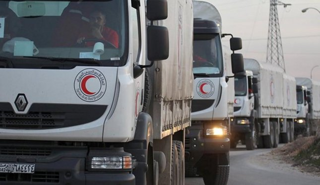 Convoys of trucks carrying food and humanitarian aid, destined for Aleppo, Syria, which were held up at the nation's border with Turkey for a week, were reportedly attacked by Syrian government forces on Monday, according to witnesses and officials. Photo courtesy Alalam, Islamic Republic of Iran Broadcasting