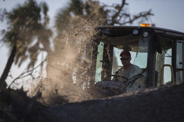 A civil engineers from the 823rd Red Horse Squadron saws through a tree at Tyndall Air Force Base, Fla., Oct. 21, 2018. About 20 percent of the base's facilities need to be demolished after it was hit by Hurricane Michael in October. Photo courtesy U.S. Air Force/Staff Sgt. Matthew Lotz