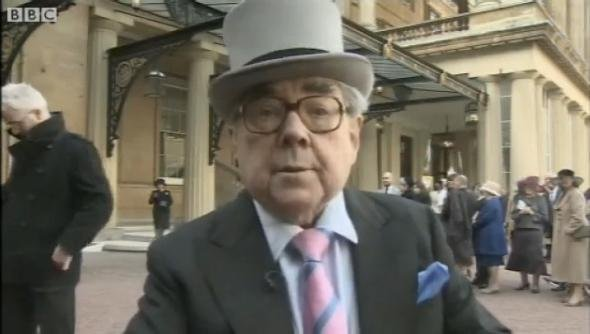 Scottish comedian Ronnie Corbett, shown here in 2012 after Queen Elizabeth named him Commander of the Order of the British Empire at Buckingham Palace, was a prolific performer best known for his work on The Frost Report and The Two Ronnies. He died March 31, 2016. Photo via AOL/BBC video screenshot