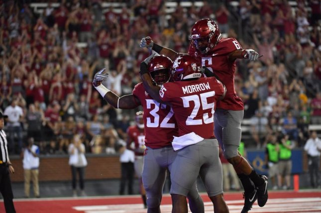 James Williams (32) scores a touchdown. Williams was the Cougars' most effective receiver, catching 13 passes out of the backfield for 163 yards, both school records for a running back, and two touchdowns. He also added 45 yards on the ground. Photo courtesy of Washington State Football/Twitter