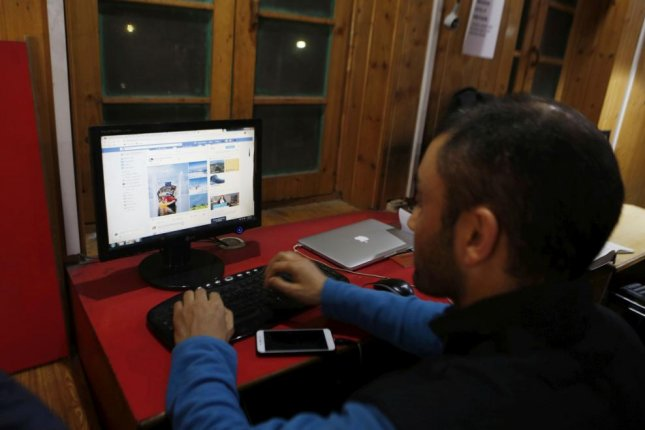 A journalist works online Wednesday in his office in Srinagar, Kashmir, after the Internet blackout was lifted. Photo by Farooq Khan/EPA-EFE
