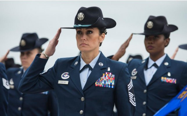 MSgt. Hope L. Skibitsky, C, leads a female military training instructor mass during a graduation ceremony at Joint Base San Antonio-Lackland, Texas. A General Accountability Office report on Tuesday noted that women leave the military at higher rates than their male counterparts. File Photo by Ismael Ortega/U.S. Air Force