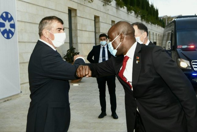 Malawi foreign minister Eisenower Mkaka (R) greets Israeli foreign minister Gabi Ashkenazi in Jerusalem on Tuesday. Photo courtesy Gabi Ashkenazi/Twitter.
