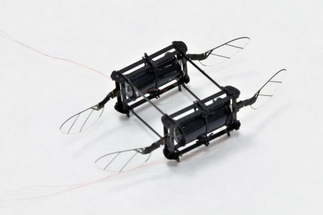 Scientists used a new soft actuator material to build a four-wing flying microbot named Robobee. Photo by Harvard Microrobotics Lab