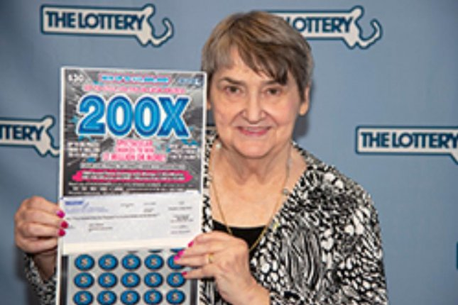 A Massachusetts woman collected a $1 million jackpot from a scratch-off lottery ticket 10 years and two months after winning her first $1 million prize. Photo courtesy of the Massachusetts State Lottery