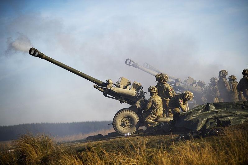 Royal Artillery soldiers fire 105mm guns. U.K. Ministry of Defense photo