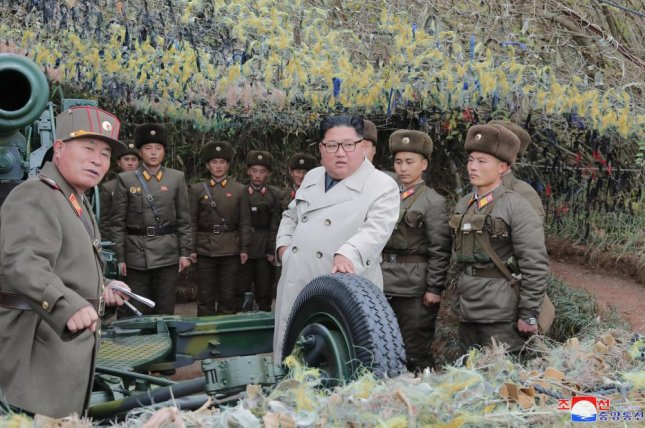 A photo released on Monday by KCNA shows Kim Jong Un (C), inspecting the defense detachment on Changrin Islet, North Korea. Photo by KCNA/EPA-EFE