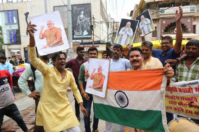 Supporters of India's Bharatiya Janata Party celebrate Monday after the government said it will end special status for Kashmir. Photo by Sanjeev Gupta/EPA-EFE