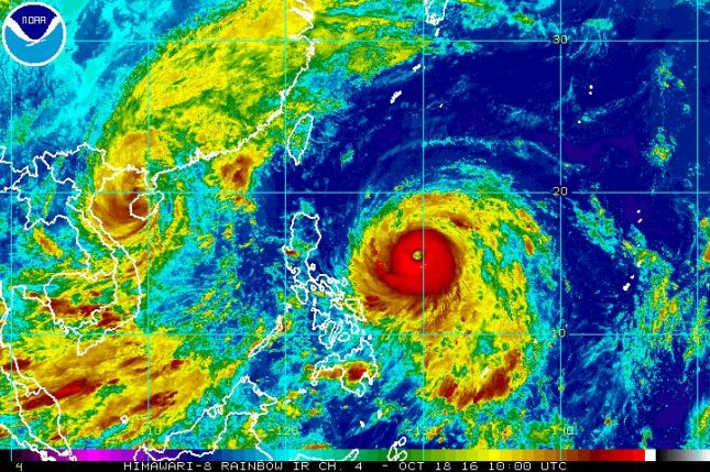 Typhoon Sarika, seen in this satellite image on the left, and Typhoon Haima, seen on the right, have threatened countries in the Pacific with strong winds and potential flooding. Sarika is forecast to near Vietnam's northern coast on Wednesday, which could worsen flooding conditions the country is already facing due to torrential rain. Image courtesy of NOAA