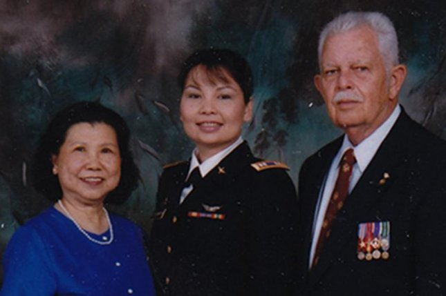 Rep. Tammy Duckworth, center, poses with her parents in this family photo posted to her campaign's Twitter account Friday. Duckworth shared the photo a day after her opponent, Republican Sen. Mark Kirk, questioned her Thai heritage and her family's history of U.S. military service. Photo courtesy Duckworth for Senate campaign