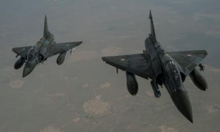 Two French Mirage 2000Ds fly over Iraq in support of Operation Inherent Resolve, a coalition of regional and international nations to defeat the Islamic State. Officials announced forces reclaimed the town of Hit on Thursday after the IS took it over in 2014. Photo by U.S. Air Force/Staff Sgt. Corey Hook