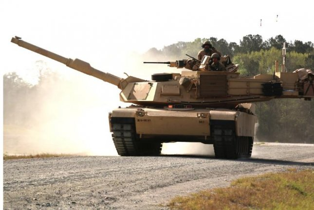 An M1A1-SA Abrams tank belonging to D Troop, 6th Squadron, 8th Cavalry Regiment, 2nd Armored Brigade Combat Team, 3rd Infantry Division, moves along the boundary road en route to its battle position during the gunnery qualification at Fort Stewart, Ga., March 29, 2018. Photo by Staff Sgt. Nathan C. Berry/U.S. Army