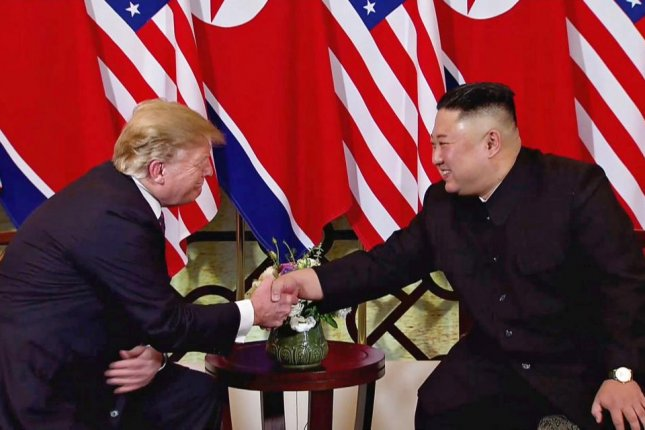 U.S. President Donald J. Trump (L) and North Korean leader Kim Jong Un (R) shake hands during the second U.S.-North Korea summit in Hanoi, Vietnam, on Wednesday. Photo by Ritchie B. Tongo/EPA-EFE