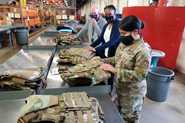 Dr. Daniel Mountjoy (left), Christine Villa, and Maj. Saily Rodriguez, with the Air Force Life Cycle Management Center's Human Systems Division, perform an inspection on new body armor units designed specifically for female Airmen in Security Forces. Photo by Brian Brackens/U.S. Air Force