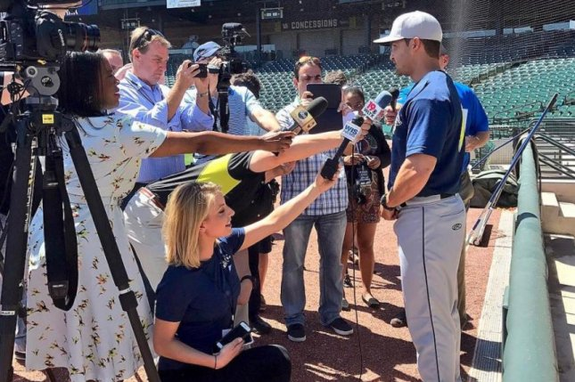 Columbia Fireflies outfielder Tim Tebow talks to reporters. Tebow now has two home runs in three games for the New York Mets' Class A affiliate. (colafireflies/Instagram)