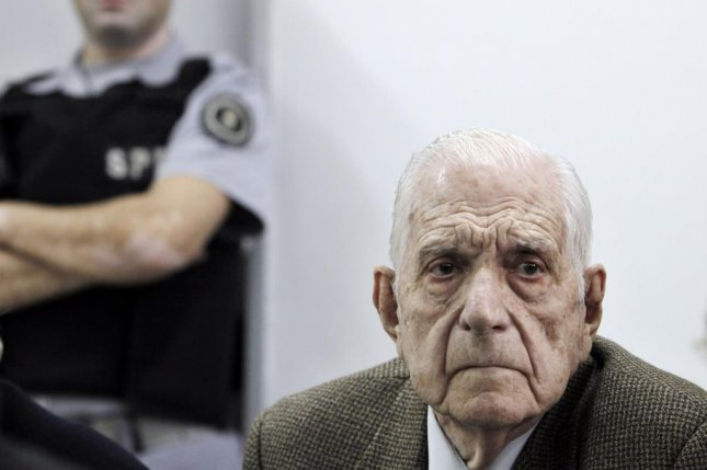 Former Argentinean dictator Reynaldo Bignone attends a court hearing in Buenos Aires on August 23, 2012. Bignone, who was found guilty of crimes against humanity in 2010, died Wednesday at the age of 90. File Photo by Leo La Valle/EPA