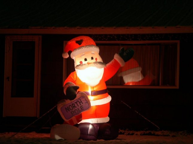 Two New Jersey men attack inflatable Santa