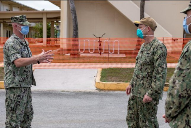 With coronavirus diagnoses in the U.S. military doubling in the past week, commanding officers wear protective face masks in Apra Harbor, Guam, on Sunday. Photo by MCS1 Julio Rivera/U.S. Navy