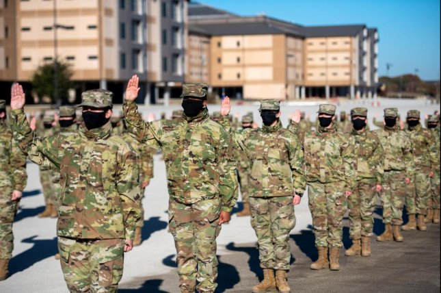 Basic military training trainees take the Oath of Enlistment during their graduation ceremony, Dec. 10 at Joint Base San Antonio-Lackland, Texas. Photo by Sarayuth Pinthong/U.S. Air Force