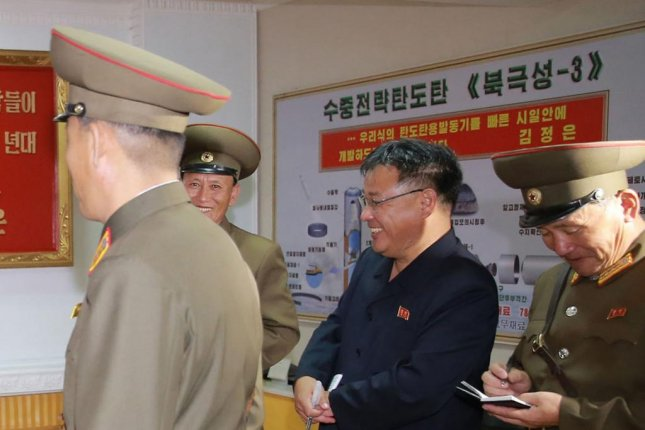 A poster of North Korea's new Pukguksong-3 submarine-launched ballistic missile is seen at the Chemical Material Institute of the Academy of Defense Science. North Korea is building more powerful submarines, according to a Japanese press report. File Photo by KCNA
