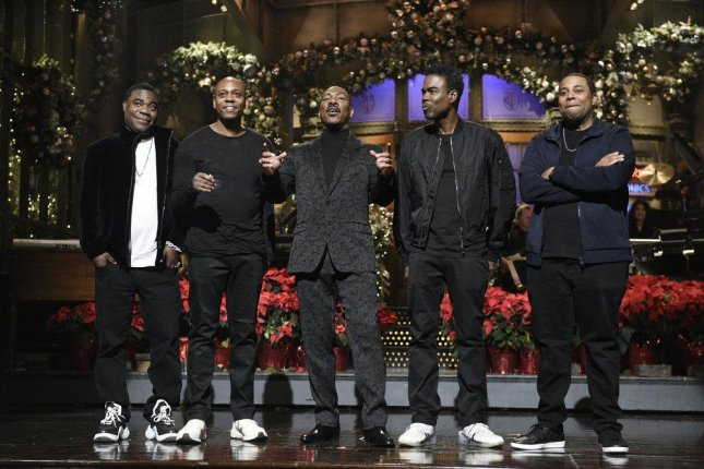 Tracy Morgan, Dave Chappelle, Eddie Murphy, Chris Rock and Kenan Thompson on this weekend's edition of Saturday Night Live. Photo by Will Heath/NBC