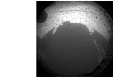This is one of the first images taken by NASA's Curiosity rover, which landed on Mars the evening of Aug. 5 PDT (morning of Aug. 6 EDT). It was taken through a fisheye wide-angle lens on one of the rover's front Hazard-Avoidance cameras at one-quarter of full resolution. The camera is the left eye of a stereo pair positioned at the middle of the rover's front side. The clear dust cover on the camera is still on in this view, and dust can be seen around its edge, along with three cover fasteners. The rover's shadow is visible in the foreground. As planned, the rover's early engineering images are lower resolution. Larger color images are expected later in the week when the rover's mast, carrying high-resolution cameras, is deployed. (NASA/JPL-Caltech)