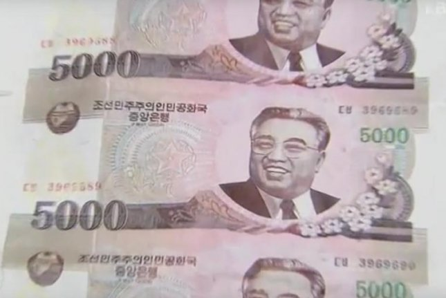 Counterfeit North Korean money printed in 5,000 North Korean won denominations were found in Seoul Tuesday. Photo screenshot of KBS TV