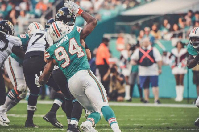 Robert Quinn (94) had 6.5 sacks in 16 starts last season for the Miami Dolphins. Photo courtesy of the Miami Dolphins