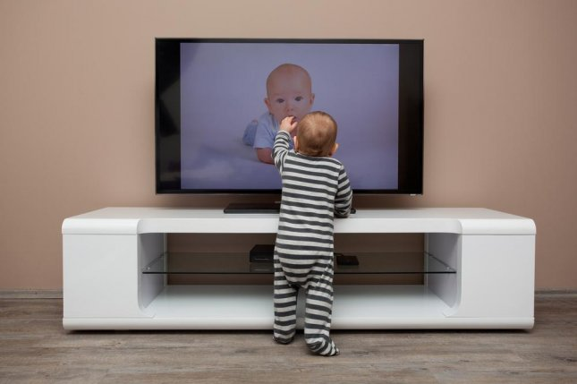 Children can easily cause a TV to fall on them by bumping furniture or the set itself, causing themselves potentially serious injury. Photo by Frantisek Czanner/Shutterstock