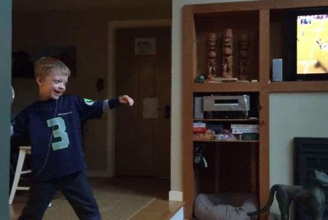 A young Seattle Seahawks fan prepares to throw a ball attached to his loose tooth. Jim Devereaux/Facebook video screenshot
