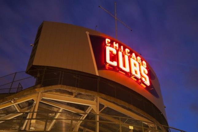 The Chicago City Council voted 35-10 Wednesday to pass a new ordinance that raises the legal purchasing age for tobacco from 18 to 21 -- and bans the use of smokeless chewing tobacco at all of the city's sports venues. The law affects fans, players and managers at both of Chicago's Major League ballparks, the Cubs' Wrigley Field (pictured) and the White Sox's U.S. Cellular Field. File photo by Henryk Sadura/Shutterstock