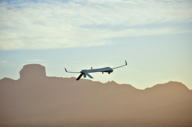 The Predator XP remotely piloted aircraft, pictured in flight, has an endurance of 35 hours in the air and fly as high as 25,000 feet off the ground. Photo courtesy of General Atomics