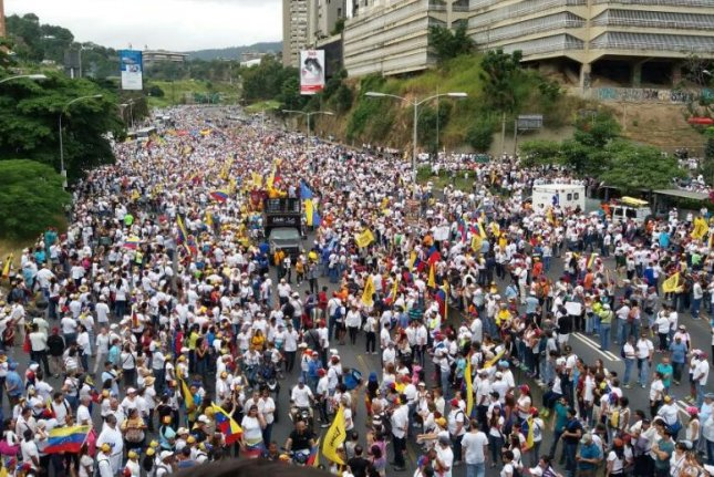 The Venezuelan opposition, consolidated in the Democratic Unity Roundtable coalition, held a large protest in Caracas on Thursday to demand that Venezuela's election commission move ahead with a referendum to recall President Nicolas Maduro before the end of the year. Photo courtesy of Democratic Unity Roundtable