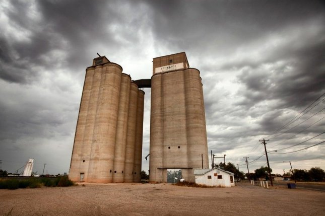 Zane Fetch, 32, entered a concrete grain elevator like the one pictured in September to break up a crust, fell through that crust, was engulfed in grain and died. Photo courtesy of Pixabay
