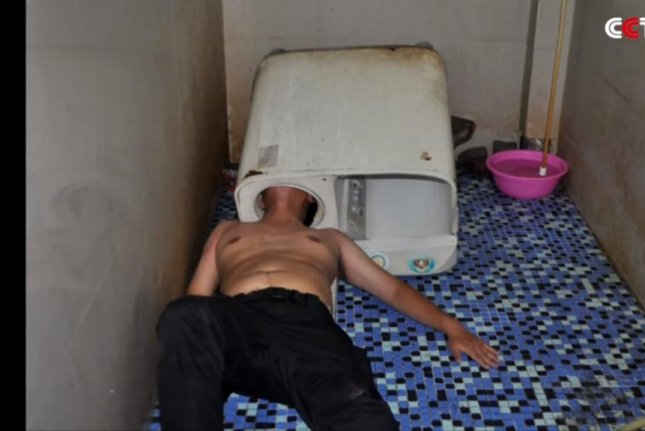 Firefighters in China freed a man whose head became stuck in a washing machine. Screenshot: CCTV+/YouTube