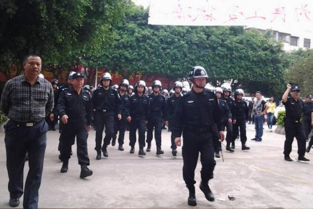 Police gather at a protest area, in a scene from filmmaker Huang Wendi's We the Workers, a three-hour documentary on the conditions of factory laborers in the Pearl River Delta. Image Courtesy of Huang Wenhai